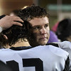 Pond Creek-Hunter's Jake Davis hugs Tyler Kerr following the Panther's loss to Tipton in the Class C state championship game Friday December 2, 2016 at Southwestern Oklahoma State University in Weatherford. (Billy Hefton / Enid News & Eagle)