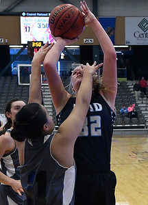 Enid's Sarah Johnson gets a hand to the face from Life Prep's Mart Ali as she puts up a shot during the 3rd place game in the Enid Holiday Classic Saturday December 31, 2016 at the Central National Bank Center. (Billy Hefton / Enid News & Eagle)