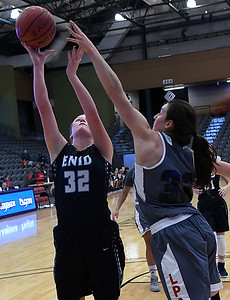 Enid's Sarah Johnson puts up a shot against Life Prep's Reagan Tibbits during the 3rd place game in the Enid Holiday Classic Saturday December 31, 2016 at the Central National Bank Center. (Billy Hefton / Enid News & Eagle)
