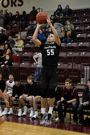 Pond Creek-Hunter's Cole Jones shoots a three point shot against Pioneer Monday December 19, 2016 at Pioneer HIgh School. (Billy Hefton / Enid News & Eagle)