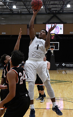 Enid's Will Phillips puts up a shot against Putnam City Tuesday December 13, 2016 ay the Central National Bank Center. (Billy Hefton / Enid News & Eagle)