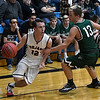 OBA's Hunter Grimm drives around Justin Howe of Thomas Friday December 16, 2016 at Oklahoma Bible Academy. (Billy Hefton / Enid News & Eagle)