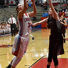 Chisholm's Bailey Brown shoots over Blackwell's Courtney Grove Thursday December 15, 2016 at Chisholm High School. (Billy Hefton / Enid News & Eagle)