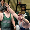 Enid's Brian Pemberton celebrates his win over James King of Edmond Santa Fe in their 220 pound match Thursday December 1, 2016 at Waller Middle School. (Billy Hefton / Enid News & Eagle)
