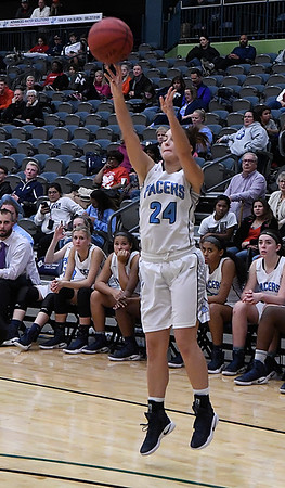 Enid's Izzy Plunkett shoots a three point shot against Putnam City Tuesday December 13, 2016 ay the Central National Bank Center. (Billy Hefton / Enid News & Eagle)