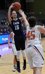 Enid's Ashley Handing shoots over Heritage's Shelby Cook Thursday December 29, 2016 during the first round of the 1st Enid Holiday Classic at the Central National Bank Center. (Billy Hefton / Enid News & Eagle)
