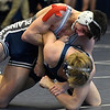 Enid's Austin Loza wrestles Edmond North's Jacob Swafford during the quarterfinal of the Mid America Nationals Saturday December10, 2016 at the Central National Bank Center. (Billy Hefton / Enid News & Eagle)