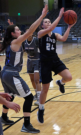 Enid's IzzyPlunkett gets around Life Prep's Manaia Timson for a shot during the 3rd place game in the Enid Holiday Classic Saturday December 31, 2016 at the Central National Bank Center. (Billy Hefton / Enid News & Eagle)