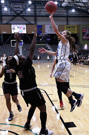 Enid's Ashley Handling shoots over Putnam City North's S'Brea Maxwell Tuesday December 6, 2016 at the CNB Center. (Billy Hefton / Enid News & Eagle)