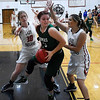 OBA's Elizabeth Price and Isabel Giles doubleteam Janice Springwater of Thomas Friday December 16, 2016 at Oklahoma Bible Academy. (Billy Hefton / Enid News & Eagle)