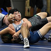 Enid's Kai Oshiro pins Nathan Campbell of Edmond Santa Fe in their 120 pound match Thursday December 1, 2016 at Waller Middle School. (Billy Hefton / Enid News & Eagle)