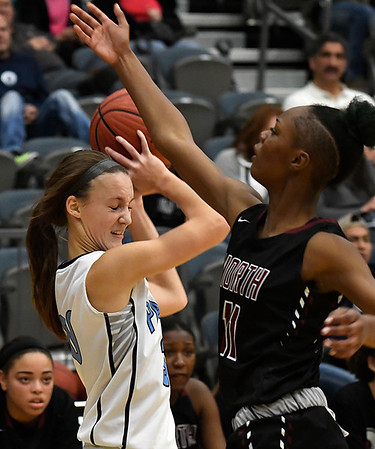 Enid's Emily Angleton is pressured by Putnam City North's Indya Motte Tuesday December 6, 2016 at the CNB Center. (Billy Hefton / Enid News & Eagle)