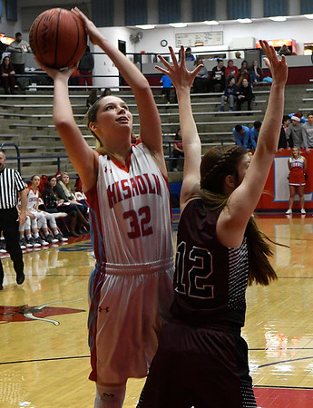 Chisholm's Jordan Rolfe shoots over Blackwell's Courtney Grove Thursday December 15, 2016 at Chisholm High School. (Billy Hefton / Enid News & Eagle)