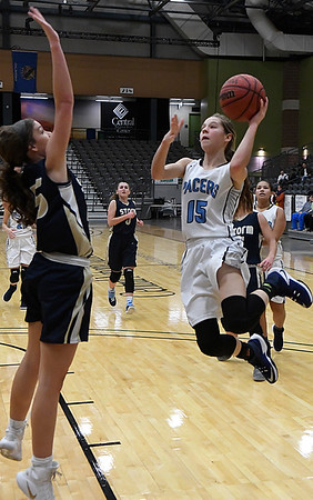 Enid's AshleyHanding goes to the basket against OKC Storm's Kaylee Smith Friday December 30, 2016 during the second day of the Enid Holiday Classic at the Central National Bank Center. (Billy Hefton / Enid News & Eagle)