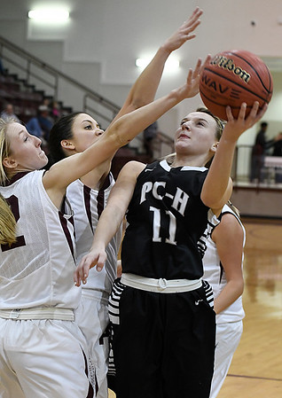 Pond Creek-Hunter's Brooke Rayner puts up a shot in the lane against Pioneer's Madison Postier Monday December 19, 2016 at Pioneer HIgh School. (Billy Hefton / Enid News & Eagle)
