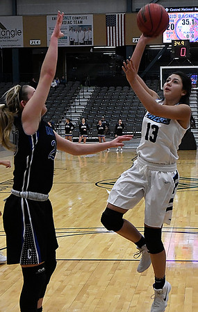Enid's Edith Vega puts up a shot against Choctaw's Mackenzie Crusoe Tuesday December 19, 2017 at the Central National Bank Center. (Billy Hefton / Enid News & Eagle)