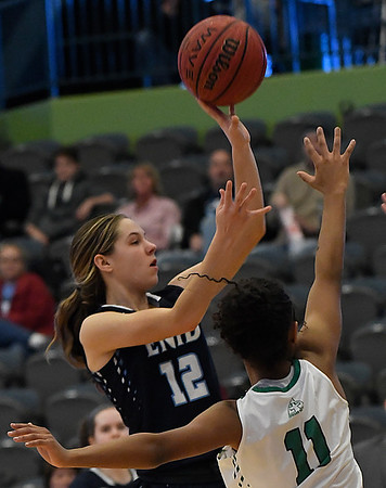 Enid's Ashley Handing shoots over Brooke West of Bishop McGuinness during the Enid Holiday Classic Basketball Tournament Saturday December 30, 2017 at the Central National Bank Center. (Billy Hefton / Enid News & Eagle)