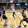 Enid's Ashley Handing puts up a shot against Stillwater during the Enid Holiday Classic Basketball Tournament Thursday December 28, 2017 at the Central National Bank Center. (Billy Hefton / Enid News & Eagle)