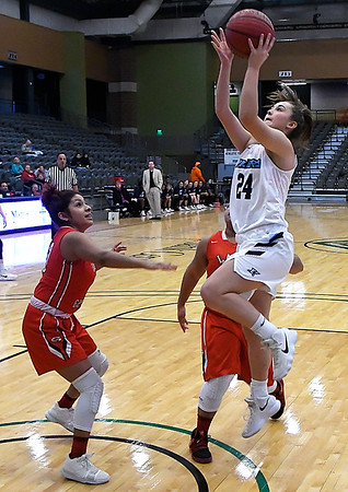 Enid's Elizabeth Plunkett puts up a shot against U.S. Grant during the Enid Holiday Classic Basketball Tournament Friday December 29, 2017 at the Central National Bank Center. (Billy Hefton / Enid News & Eagle)