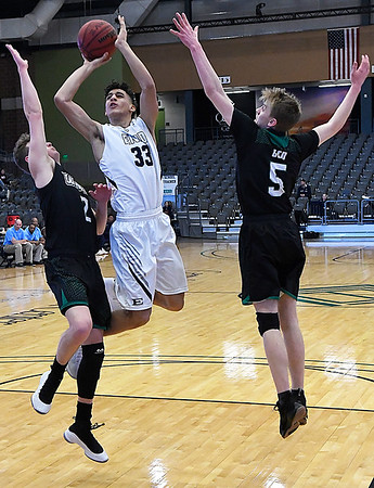 Enid's Cyson Mathis puts up a shot between Green Country's Marshall LaBar and Gavin Stiles during the Enid Holiday Classic Basketball Tournament Friday December 29, 2017 at the Central National Bank Center. (Billy Hefton / Enid News & Eagle)