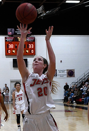 NOC Enid's Andi Pierce scores against NOC Tonkawa Wednesday December 6, 2017 at the NOC Mabee Center. (Billy Hefton / Enid News & Eagle)