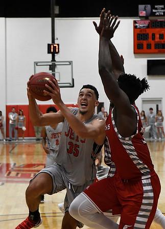 NOC Enid's Houston Johnson goes to the basket against NOC Tonkawa's Anselm Uzuegbunem  Wednesday December 6, 2017 at the NOC Mabee Center. (Billy Hefton / Enid News & Eagle)