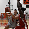 NOC Enid's Houston Johnson goes to the basket against NOC Tonkawa's Anselm Uzuegbunem  Wednesday December 6, 2017 at the NOC Mabee Center. (Billy Hefton / Enid News & Eagle)