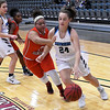 Enid's Elizabeth Plunkett drives toward the basket against U.S. Grant's Page Peevy during the Enid Holiday Classic Basketball Tournament Friday December 29, 2017 at the Central National Bank Center. (Billy Hefton / Enid News & Eagle)