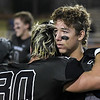 Pond Creek-Hunter's Zac Davis and Colton Gibson hug following the Panther's 56-8 loss to Tipton in the class C state championship game Friday December 1, 2017 at SWOSU in Weatherford. (Billy Hefton / Enid News & Eagle)