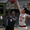 Enid's Carlos Menefield goes up for a shot in the lane against HFC's David Harris during the Enid Holiday Classic Basketball Tournament Thursday December 28, 2017 at the Central National Bank Center. (Billy Hefton / Enid News & Eagle)