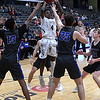 Enid's Carlos Menefield looks for help while surrounded by Choctaw defenders Tuesday December 19, 2017 at the Central National Bank Center. (Billy Hefton / Enid News & Eagle)
