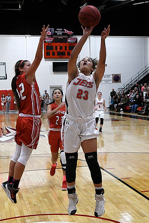 NOC Enid's Tanara Combs shoots against NOC Tonkawa's Kaitlyn Hodgins Wednesday December 6, 2017 at the NOC Mabee Center. (Billy Hefton / Enid News & Eagle)