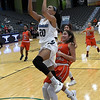 Enid's Tia jackson drives to the basket against U.S. Grant's Daisy Salas during the Enid Holiday Classic Basketball Tournament Friday December 29, 2017 at the Central National Bank Center. (Billy Hefton / Enid News & Eagle)