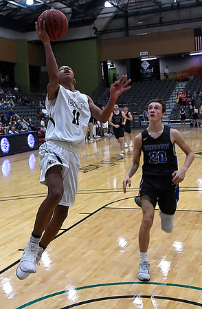 Enid's Darrin Ryan gets behind Choctaw's Kyle Gauthier to score a fastbreak basket Tuesday December 19, 2017 at the Central National Bank Center. (Billy Hefton / Enid News & Eagle)