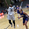 Enid's Breeasha Shaver drives the lane against Stillwater's Brooke Rayner during the Enid Holiday Classic Basketball Tournament Thursday December 28, 2017 at the Central National Bank Center. (Billy Hefton / Enid News & Eagle)