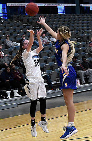Enid's Cayti Moeller shoots over Stillwater's Brooke Rayner during the Enid Holiday Classic Basketball Tournament Thursday December 28, 2017 at the Central National Bank Center. (Billy Hefton / Enid News & Eagle)