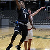 Enid's Jerra Williams gets pass HFC's Braxton Banks for a shot during the Enid Holiday Classic Basketball Tournament Thursday December 28, 2017 at the Central National Bank Center. (Billy Hefton / Enid News & Eagle)