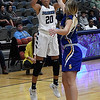 Enid's Tia Jackson shoots over Stillwater's Brooke Rayner during the Enid Holiday Classic Basketball Tournament Thursday December 28, 2017 at the Central National Bank Center. (Billy Hefton / Enid News & Eagle)