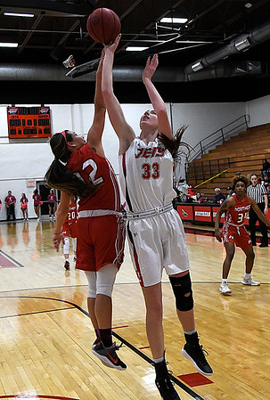 NOC Enid's Taylor Sylvester shoots over NOC Tonkawa's Kaitlyn Hodgins Wednesday December 6, 2017 at the NOC Mabee Center. (Billy Hefton / Enid News & Eagle)