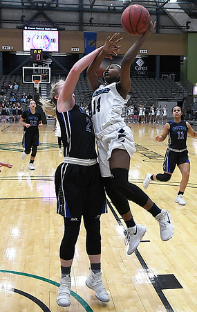 Enid's Zurae Robinson drives to the basket against Choctaw's Jordan Saxton Tuesday December 19, 2017 at the Central National Bank Center. (Billy Hefton / Enid News & Eagle)
