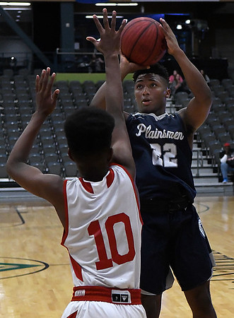 Enid's Telin Phillips shoots over HFC's Jayden Hill during the Enid Holiday Classic Basketball Tournament Thursday December 28, 2017 at the Central National Bank Center. (Billy Hefton / Enid News & Eagle)