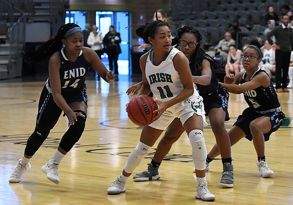 Enid's Zurae Robinson, Mya Edwards and Kaiaesha Shaver pressure Brooke West of Bishop McGuinness during the Enid Holiday Classic Basketball Tournament Saturday December 30, 2017 at the Central National Bank Center. (Billy Hefton / Enid News & Eagle)