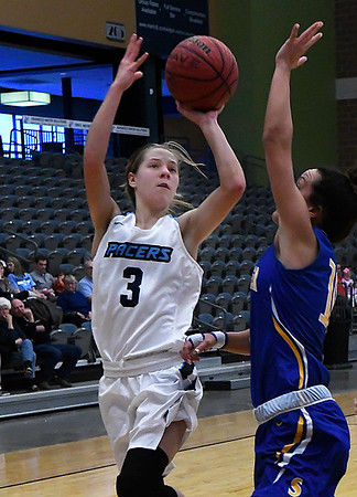 Enid's Ashley Handing puts up a shot against Stillwater's Taylor Tuck during the Enid Holiday Classic Basketball Tournament Thursday December 28, 2017 at the Central National Bank Center. (Billy Hefton / Enid News & Eagle)
