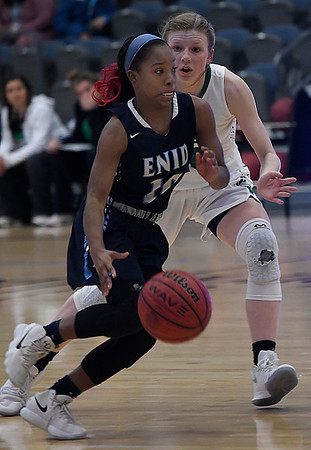 Enid's Breeasha Shaver dribbles upcourt against pressure from Meg Tidholm of Bishop McGuinness during the Enid Holiday Classic Basketball Tournament Saturday December 30, 2017 at the Central National Bank Center. (Billy Hefton / Enid News & Eagle)