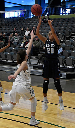 Enid's Tia Jackson shoots over Maddie McClug of Bishop McGuinness during the Enid Holiday Classic Basketball Tournament Saturday December 30, 2017 at the Central National Bank Center. (Billy Hefton / Enid News & Eagle)