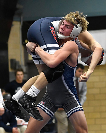 Enid's Austin Hisey lifts Ponca City's Cody Wynn during his win in their 120 pound match Tuesday December 5, 2017 at Waller Middle School. (Billy Hefton / Enid News & Eagle)