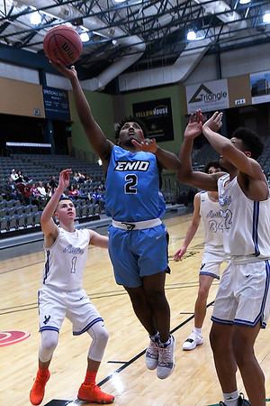 Enid's Telin Phillips puts up a shot against Deer Creek during the championship game of the Enid Holiday Classic Saturday December 29, 2018 at the Central National Bank Center. (Billy Hefton / Enid News & Eagle)