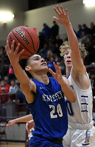 Hennessey's Angel Rodriguez puts up a shot against Hooker's Ethan Parsons during the championship game of the Mustang Stampede at Pioneer High School Friday December 7, 2018. (Billy Hefton / Enid News & Eagle)