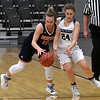 Enid's Claire Dodds tries to steal the ball from Heritage's Sydney Kinnamon during the first round of the Enid Holiday Classic Thursday December 27, 2018 at the Central National Bank Center. (Billy Hefton / Enid News & Eagle)