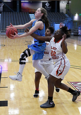 Enid's Ashley Handing goes up between U.S. Grant defenders Danisha Foster and Breya Smith during the Enid Holiday Classic Friday December 28, 2018 at the Central National Bank Center. (Billy Hefton / Enid News & Eagle)